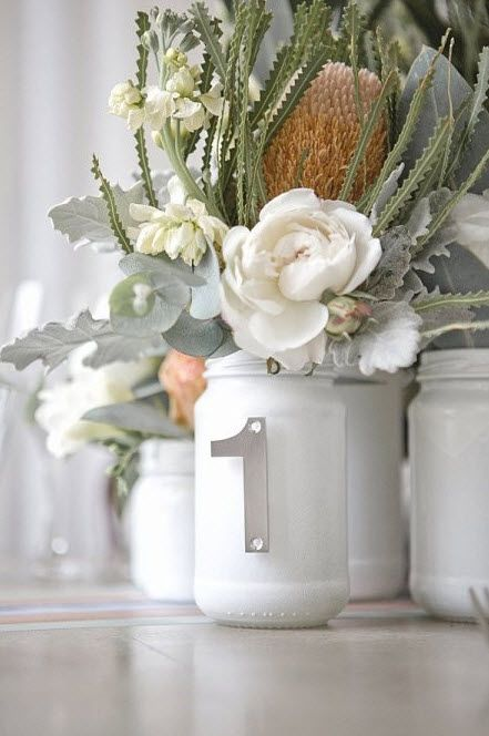 Table numbers on painted mason jars and flowers for a centerpiece #DIY #wedding