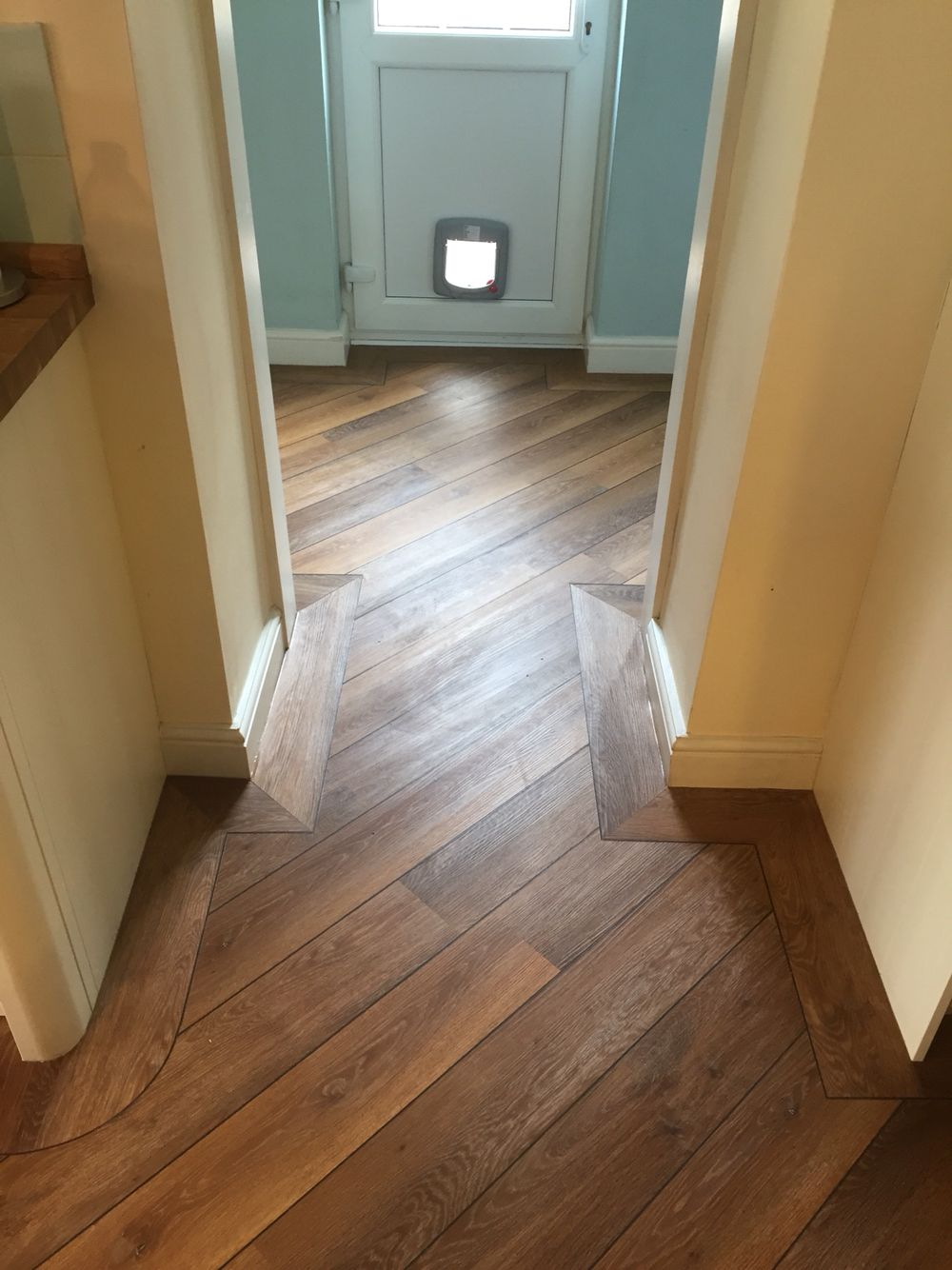 Karndean Wood Laid To Kitchen And Utility With Border And