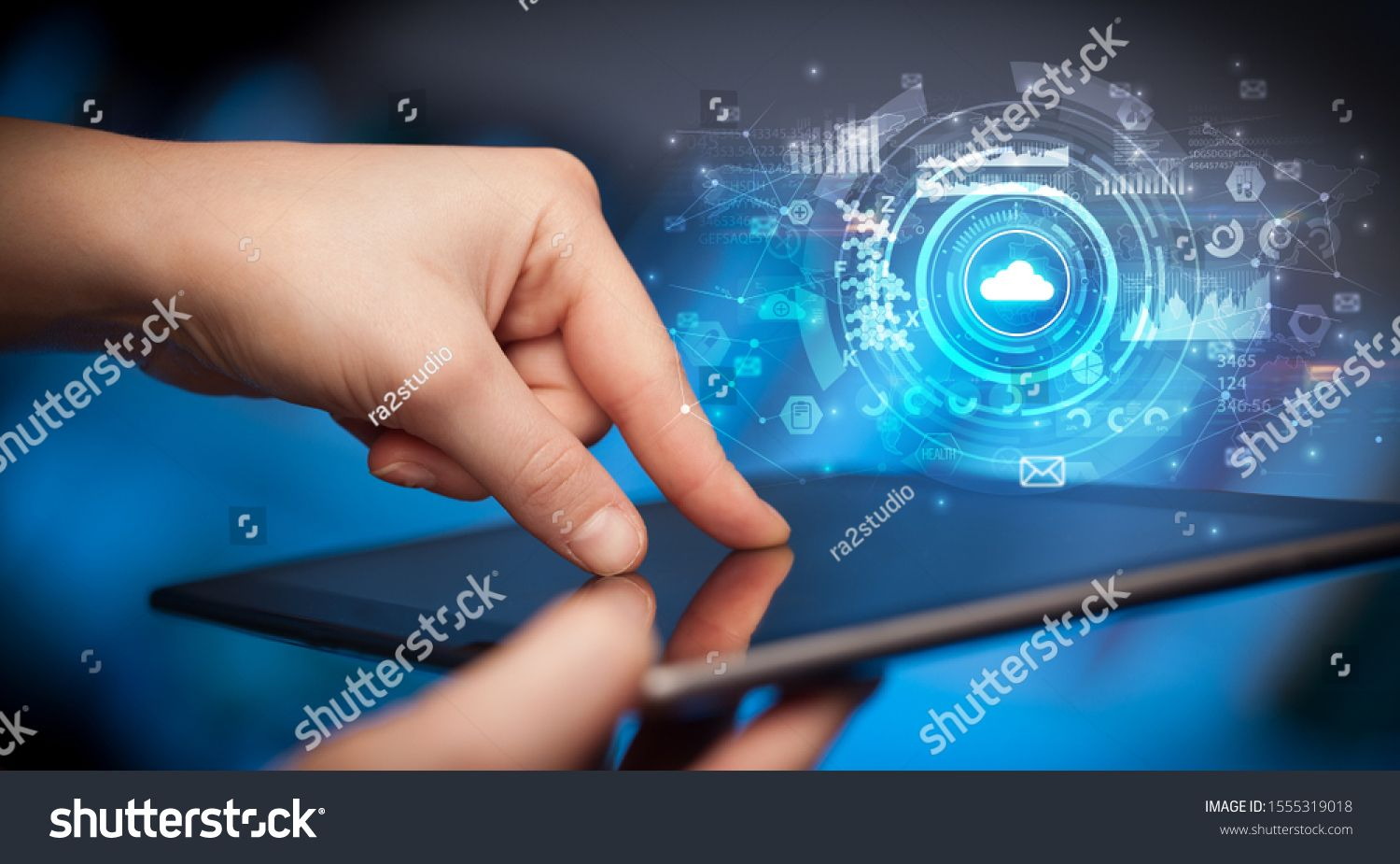 Hand holding tablet with cloud storage technology concept