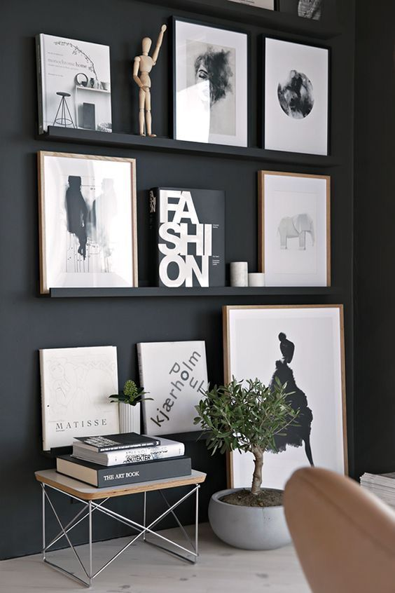 Photo of Pictures on black wall