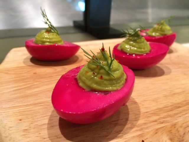 These eggs are pickled in beet juice, giving the whites a purple tint—and distinct, tangy flavor—and they're topped with chive crème fraîche. You'll want to Hulk Smash them into your mouth. Immediately. Find them at El Comado in Gotham West Market.   - Delish.com