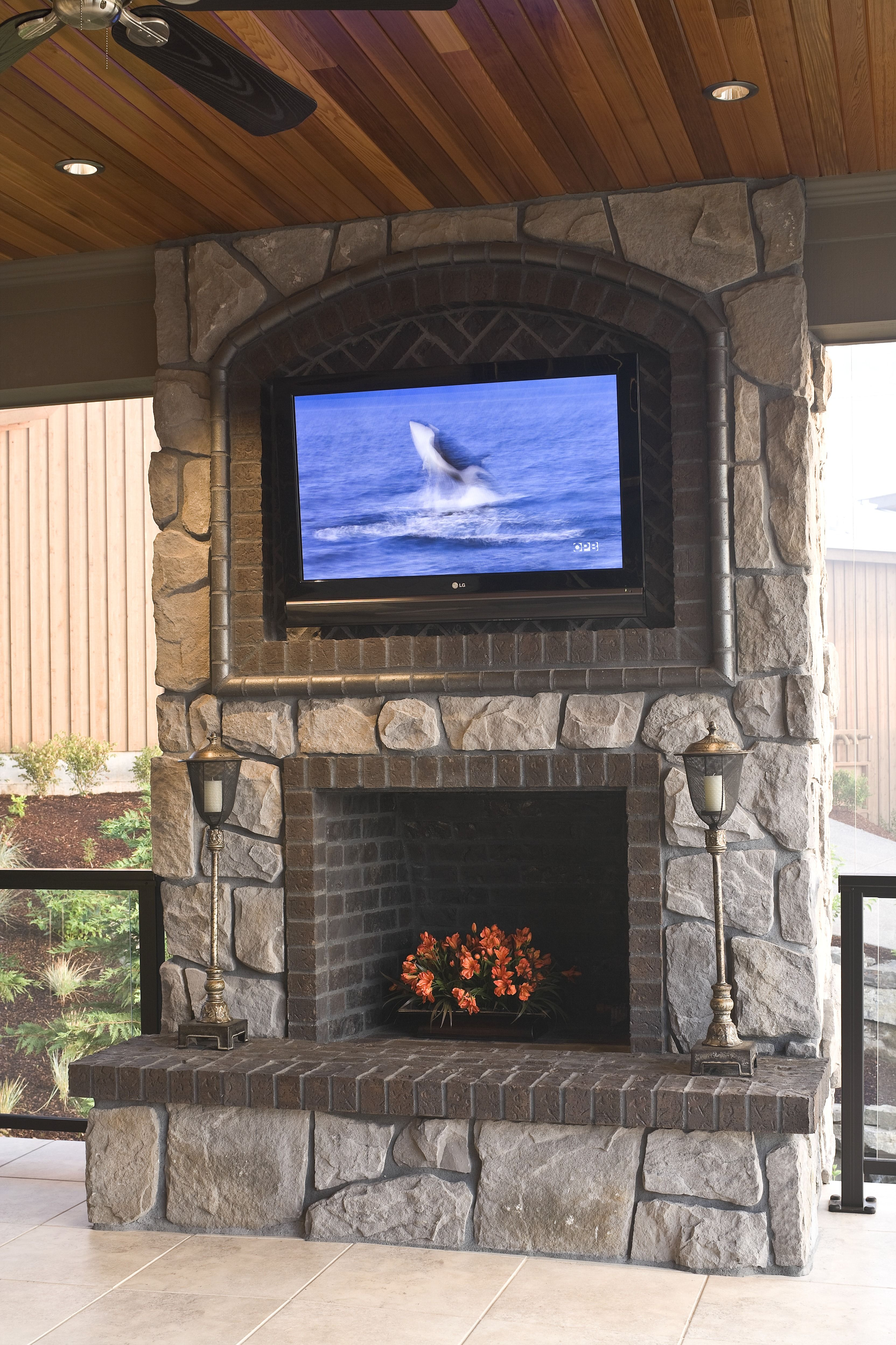 This Is The Perfect Patio For Watching A Movie Or Hanging Out With Friends The Large Rock Chimne Outdoor Gas Fireplace Build Outdoor Fireplace Patio Fireplace