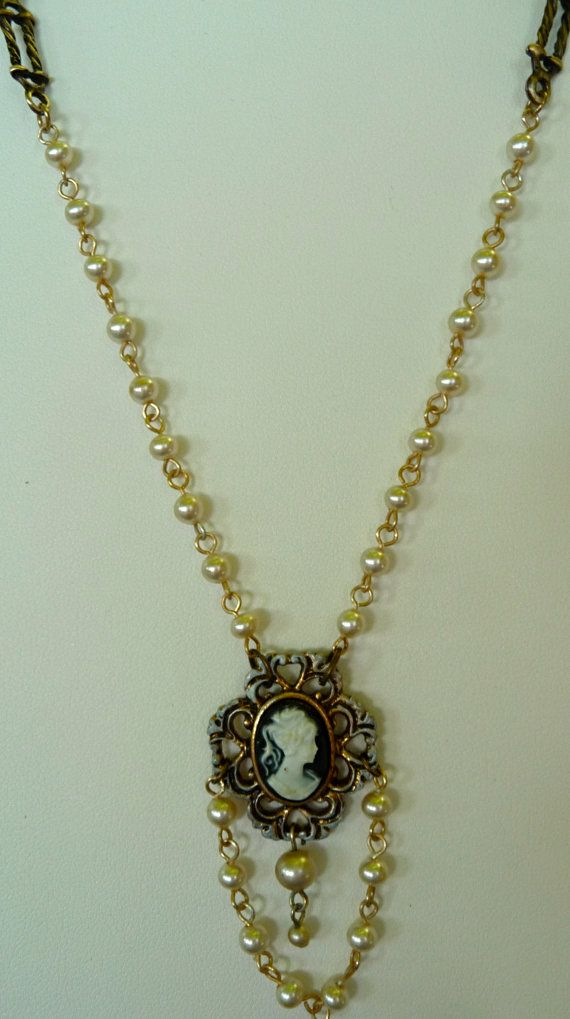 Repurposed cameo pendant  faux pearls and by RetroSmythDesigns, $35.00
