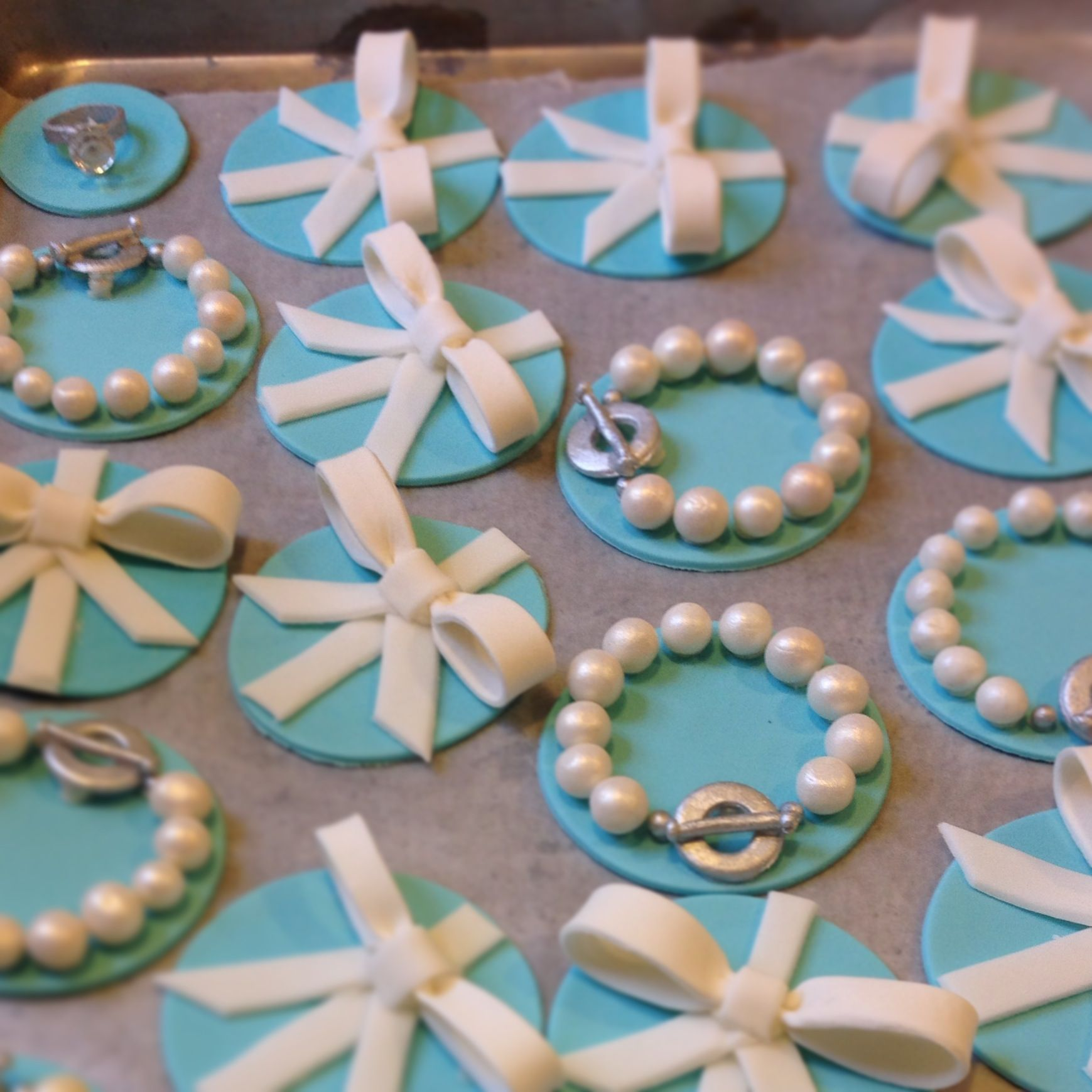 Tiffany & Co. Themed cupcake toppers, bracelets, bows and rings.
