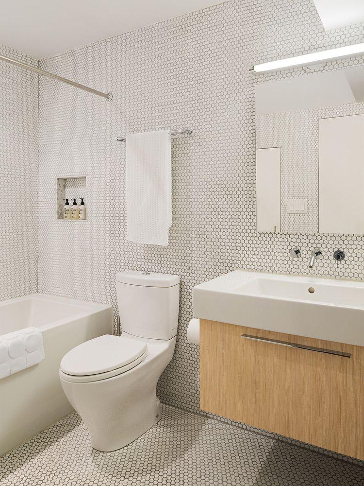 Mid Century Update By Studio Robert Jamison Plastolux Black Faucet Bathroom Mid Century Modern Makeover Tile Bathroom