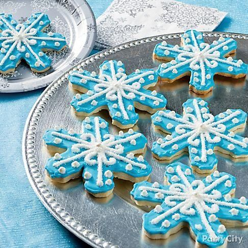 Snow is falling in sweet abundance! You'll need a decorating bag with tips, icing color and some sprinkles & sugar pearls to create these Snowflake Cookies!