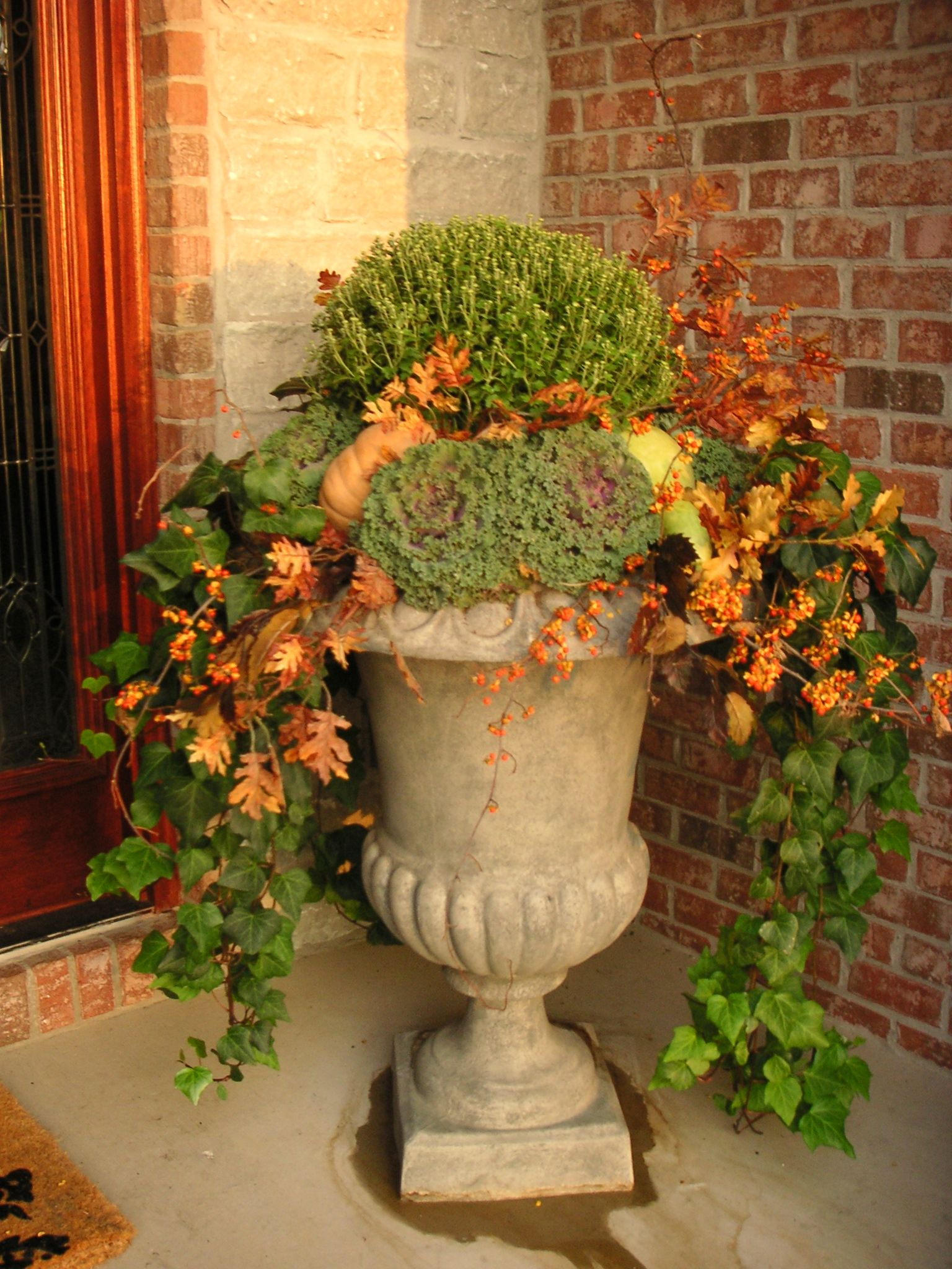 Idea for autumn garden urn. Mums, fall leaves, flowering