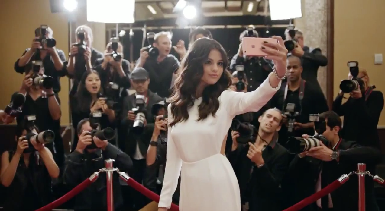 "Selena Gomez wears the HOUGHTON silk open back ""Cheyne"" gown in the new Apple iPhone 6s commercial. Available online at Houghtonnyc.com/shop now!"