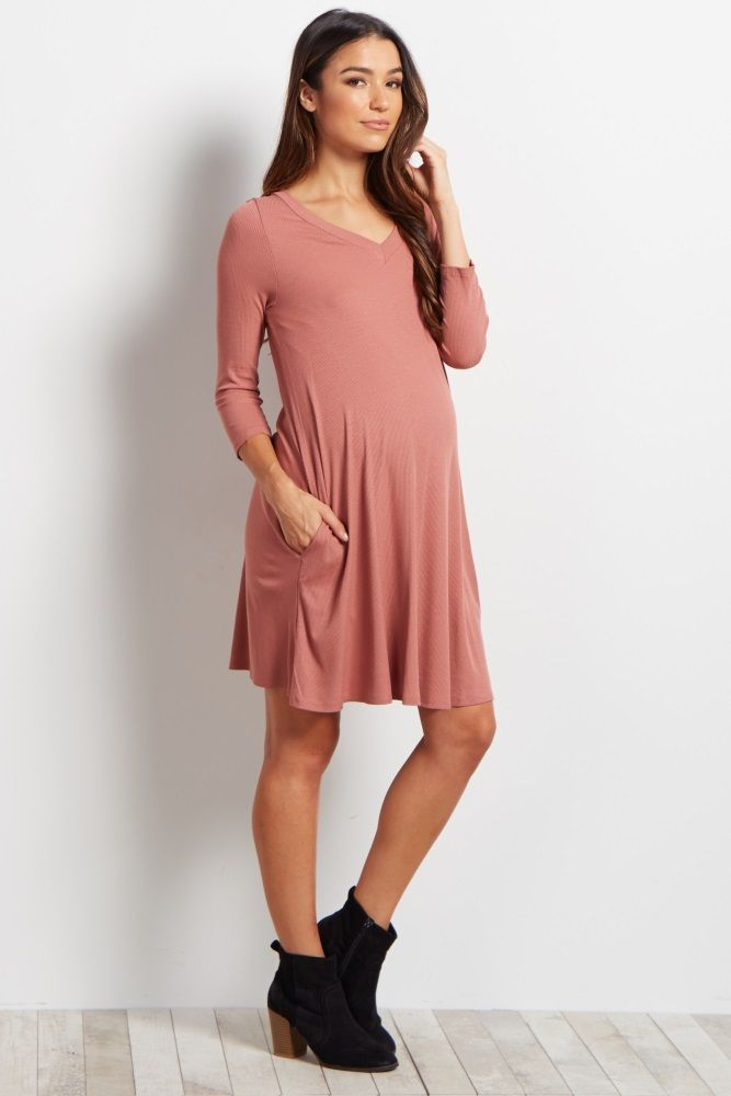 You can be sure to always feel stylish and comfortable in this ribbed maternity dress. Keep cool in any weather with 3/4 sleeves, and show off your bump from one week to the next. Style this dress with a statement necklace and wedges for a gorgeous, everyday ensemble.
