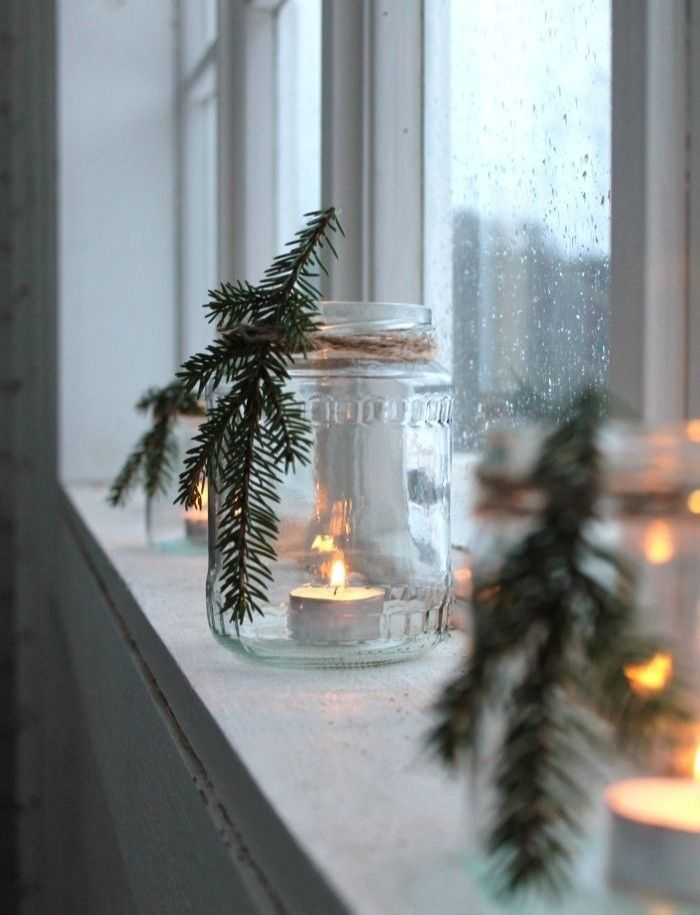 DIY winter decor. Tea lights in rustic glass jar with rope-tied pine needles.Substitute dried floral or seasonal flowers for a year-round look. #christmasweddingideas