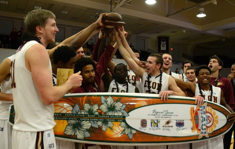 The Elon Phoenix Men S Basketball Team Celebrate Its Overtime Triumph In The Ea Sports Maui Invitational Regional W University Athlete Sports Basketball Teams