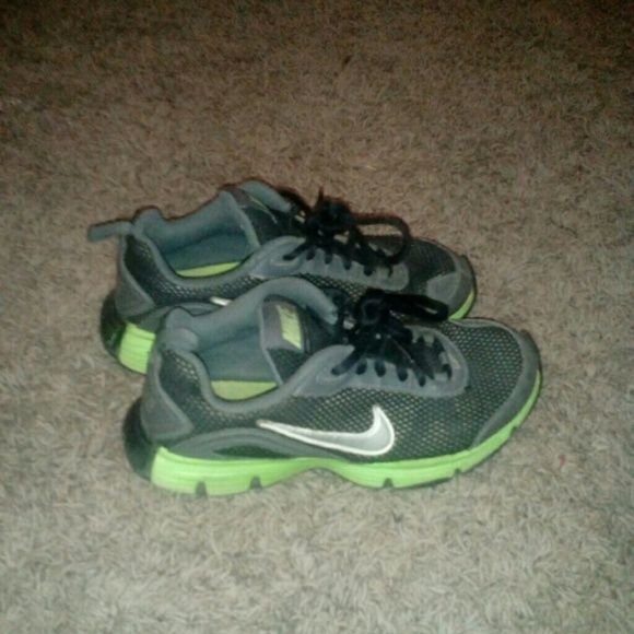 Nike running shoes Dual Fusion TRll Nike. Gray, black, neon green. Willing to go down in price. Just wanting to get rid of these ! There a 4.5 in youth. Shoes Athletic Shoes