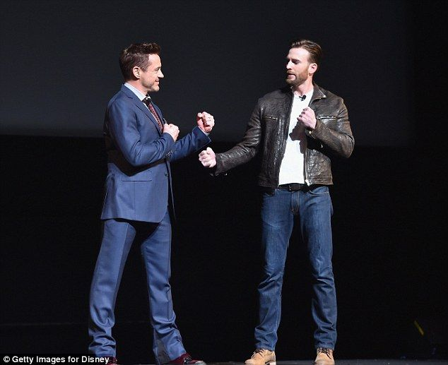Playing nice: He took to the stage and put up his fists with Captain America star Chris Evans