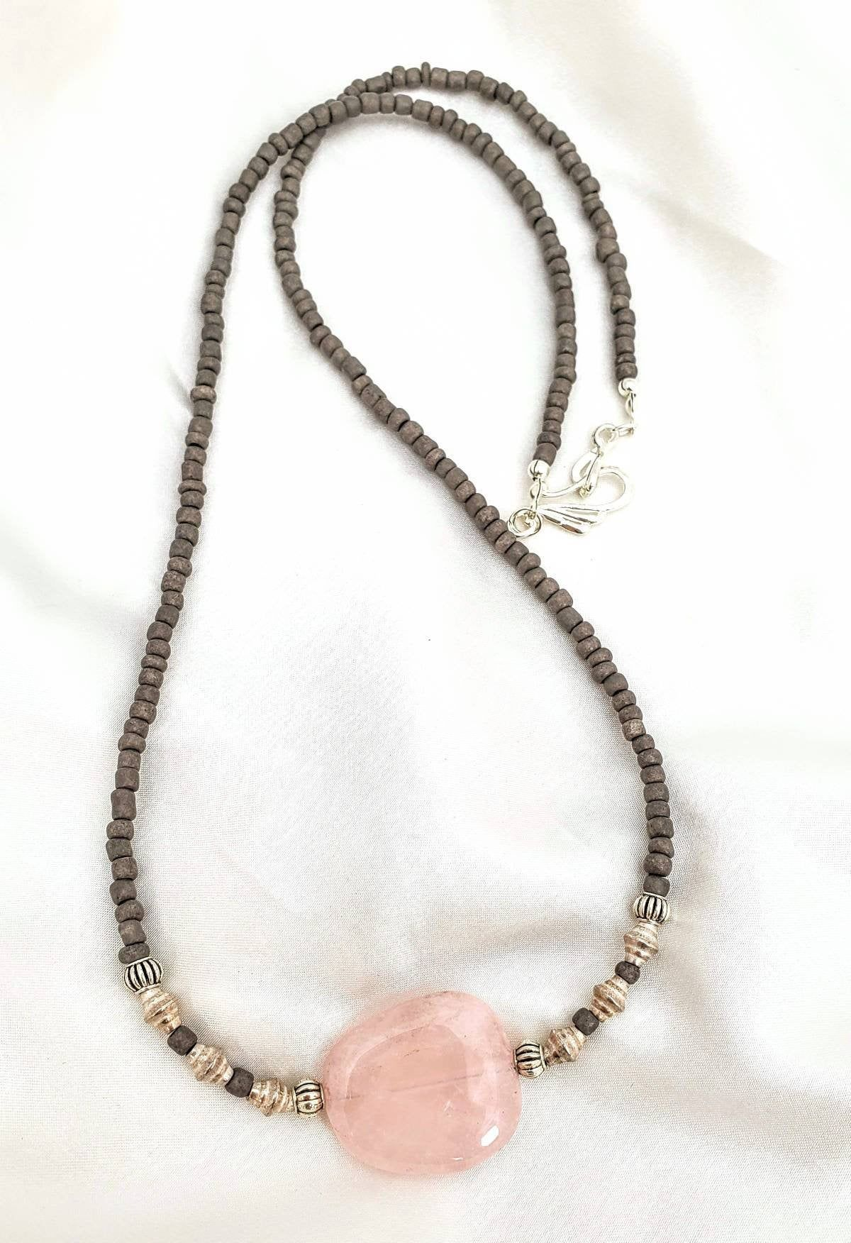 Minimalist boho rose quartz necklace. Irregular pebble gemstone. Ultra long, layering jewelry. Pink & gray, textured silver accents.
