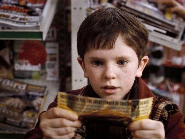 Still of Freddie Highmore with golden ticket in Charlie ...
