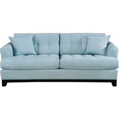 Relax on this sophistacted sofa from the cindy crawford for The couch potato furniture