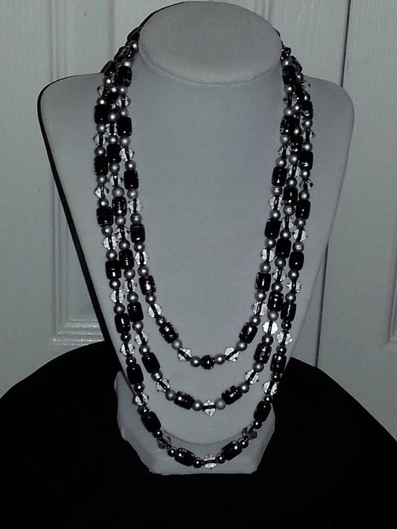 Triple stranded black glass, crystal and silver beaded necklace on Etsy, $19.00
