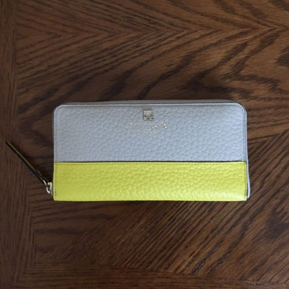 Kate Spade Southport Avenue Neda Wallet Brand new Kate Spade Southport Avenue Neda Wallet. Pebbled embossed cowhide 2 tone, zip around closure, fabric lining, 12 card slots, billfold slots, center zip compartment and exterior pocket kate spade Bags Wallets