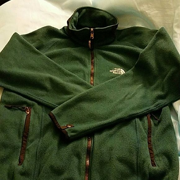 North Face full zip fleece In greatly used condition for women in the color forest green, needs a new home. North Face Jackets & Coats