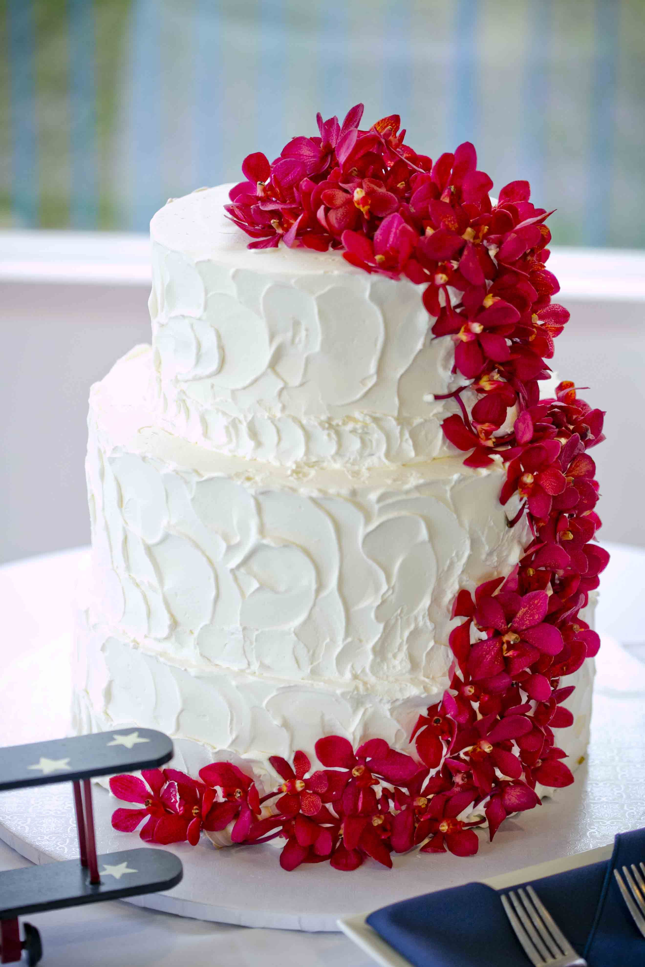 Simple White Cake With Magenta Waterfall Of Flowers Wedding Cakes