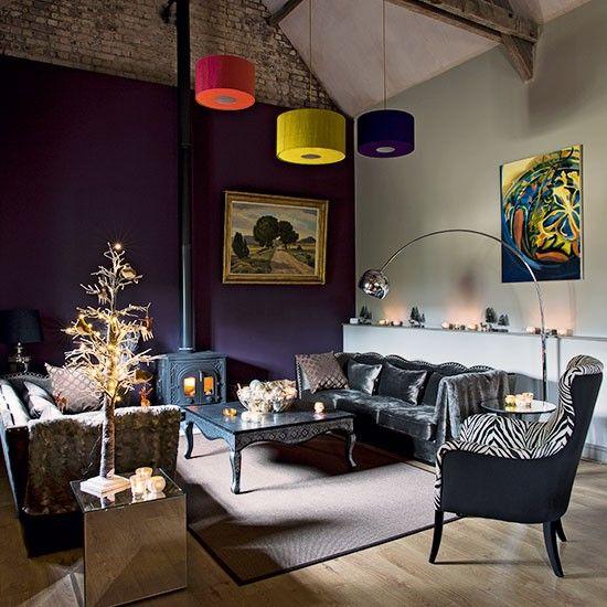 Purple living room with grey velvet sofa