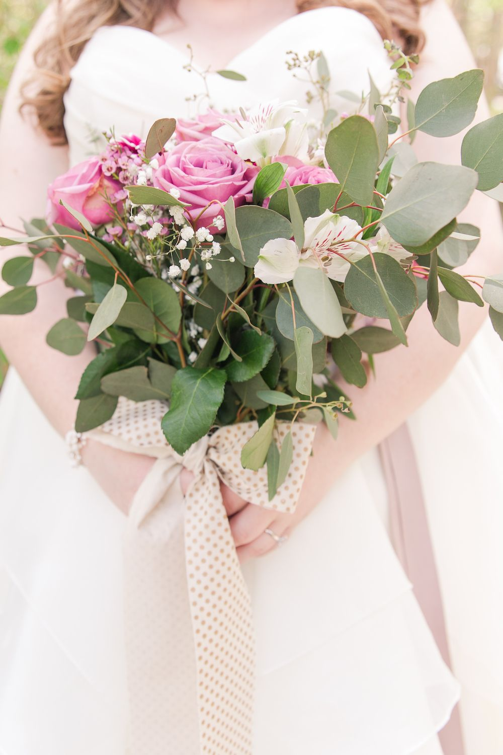 Bridal bouquet with silver dollar eucalyptus and pink roses