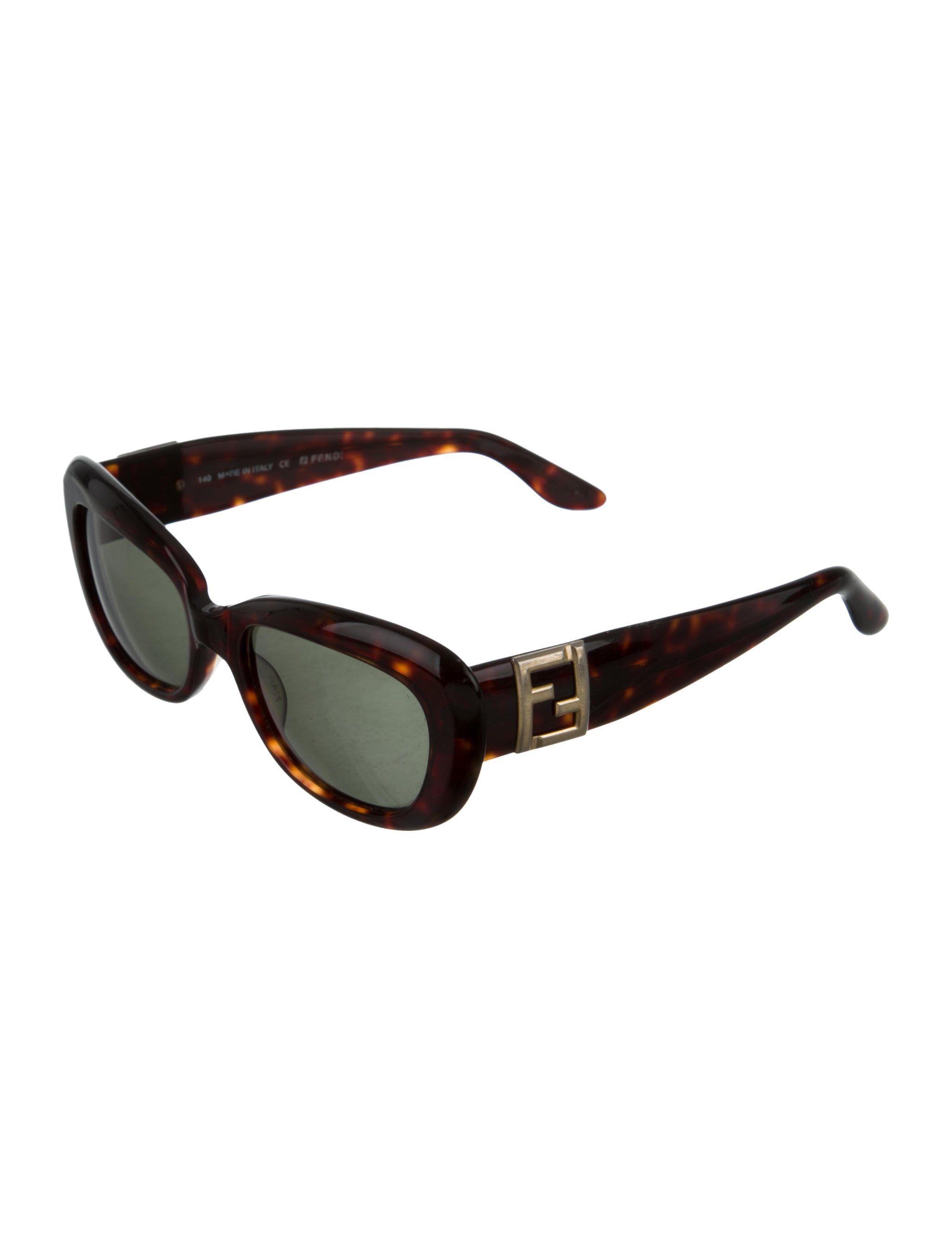 17ad8370393 Brown and black acetate Fendi tortoiseshell sunglasses with tinted lenses  and logos at arms.