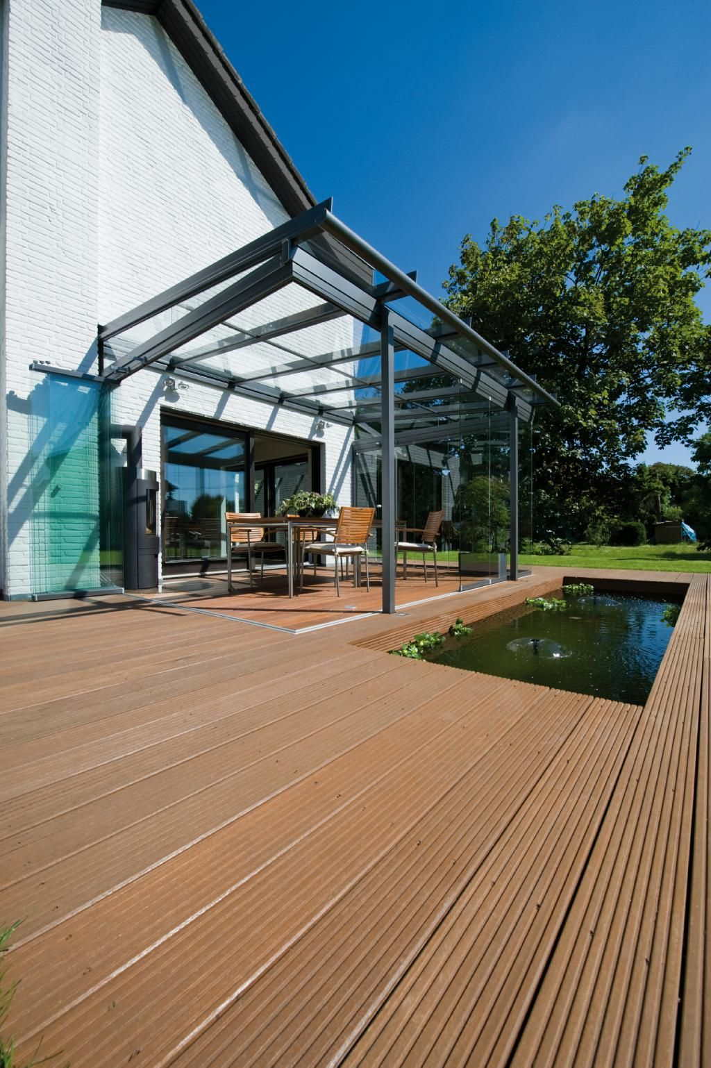 ein platz an der sonne das solarlux glashaus bestehend aus einem sdl atrium dach mit sl 25. Black Bedroom Furniture Sets. Home Design Ideas