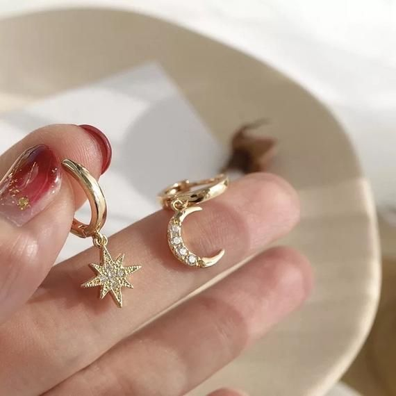 Photo of 18k gold plated moon and star mis-matched huggie earrings for women, celestial huggies, dainty huggi