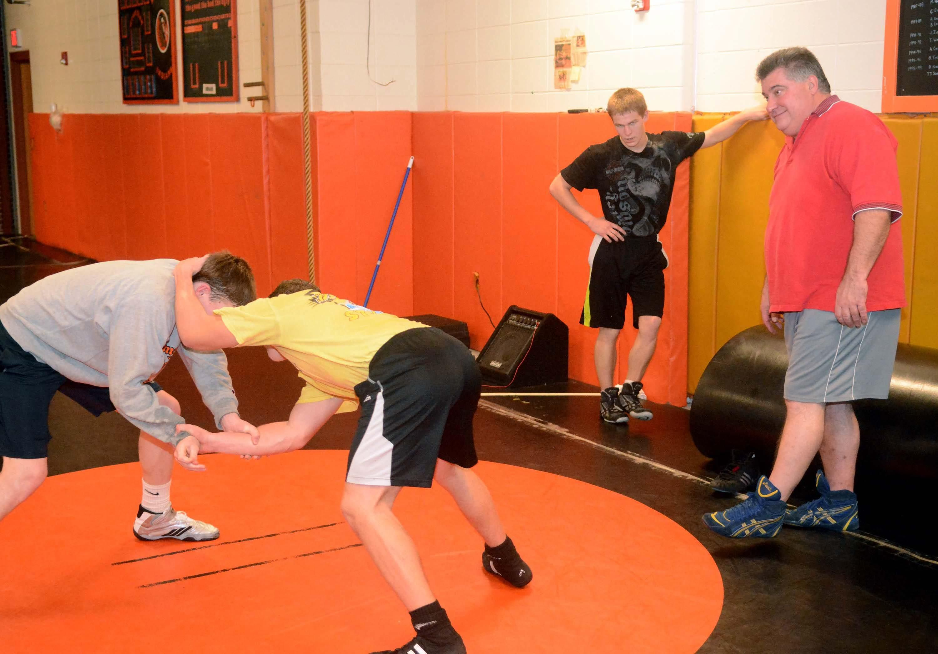 Montville coach Gary Wilcox, right, watches wrestling