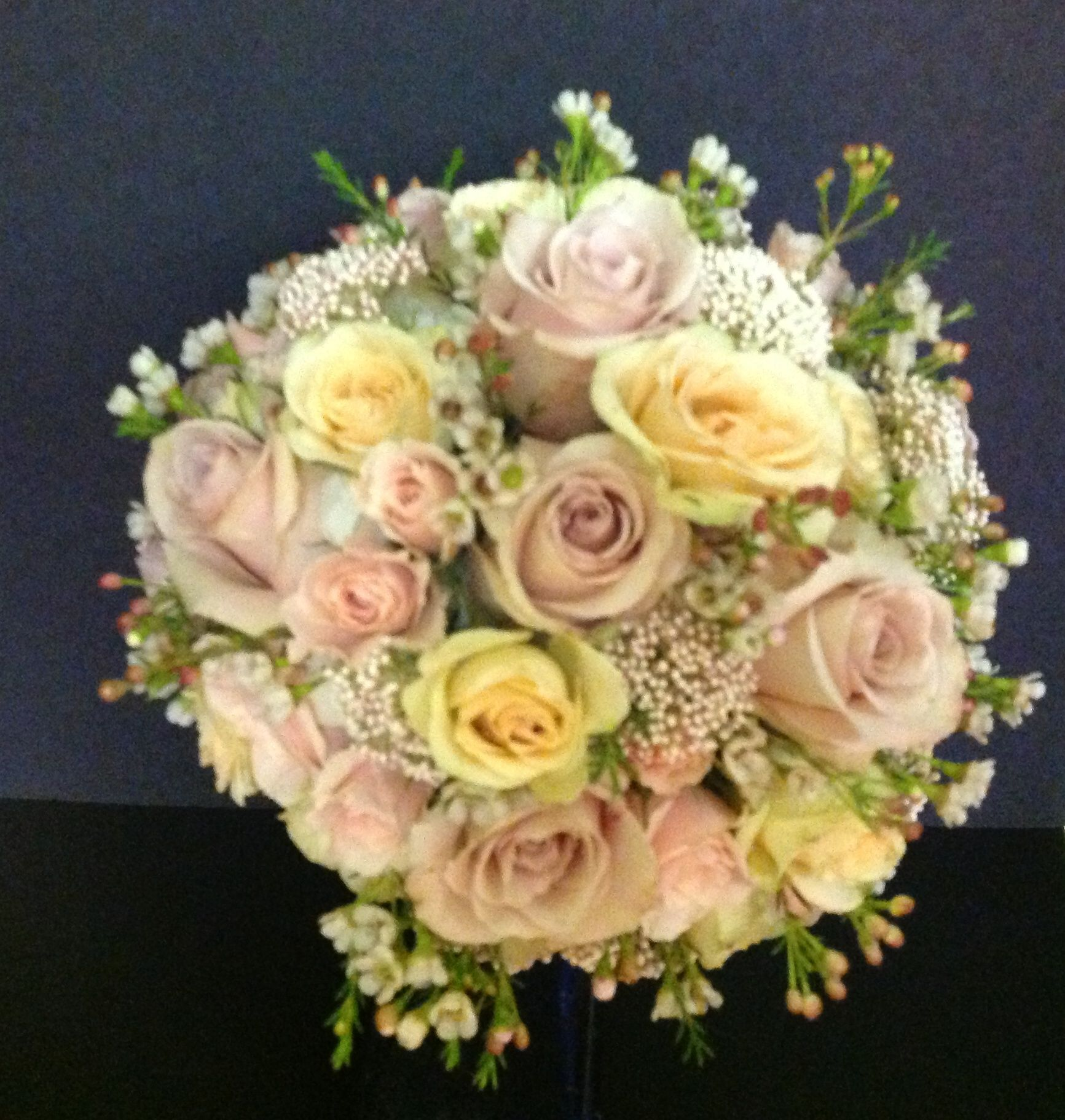 Champagne and Porcelina roses are combined with hyacinth, blush pink waxflower, and riceflower in this stunning bouquet.  See more wedding bouquets, centerpieces, and more at www.jeffmartinsweddings.com