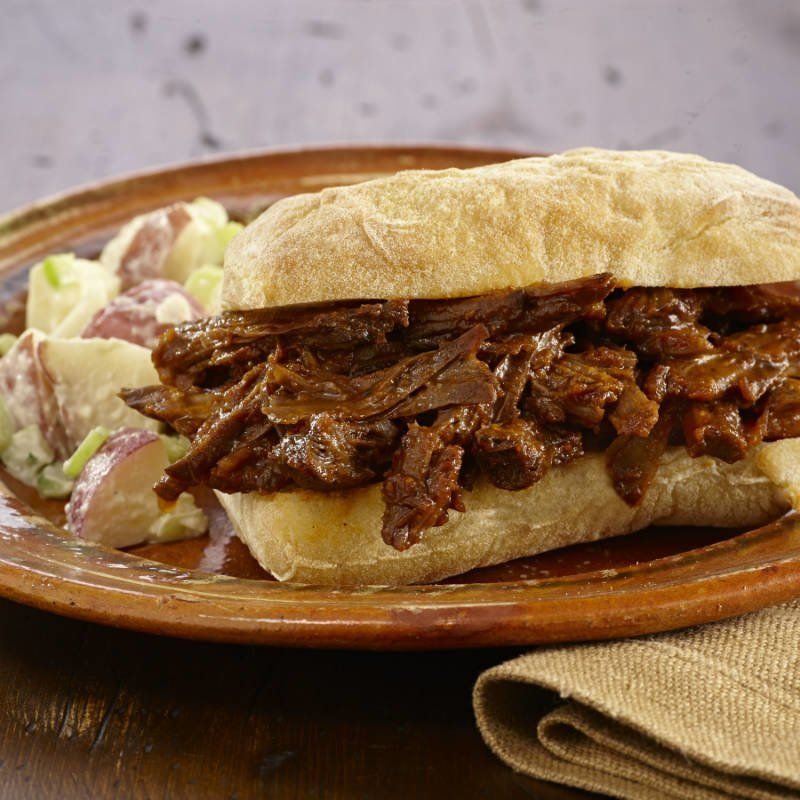 Serve this tender and flavorful BBQ pulled beef on sandwich rolls.