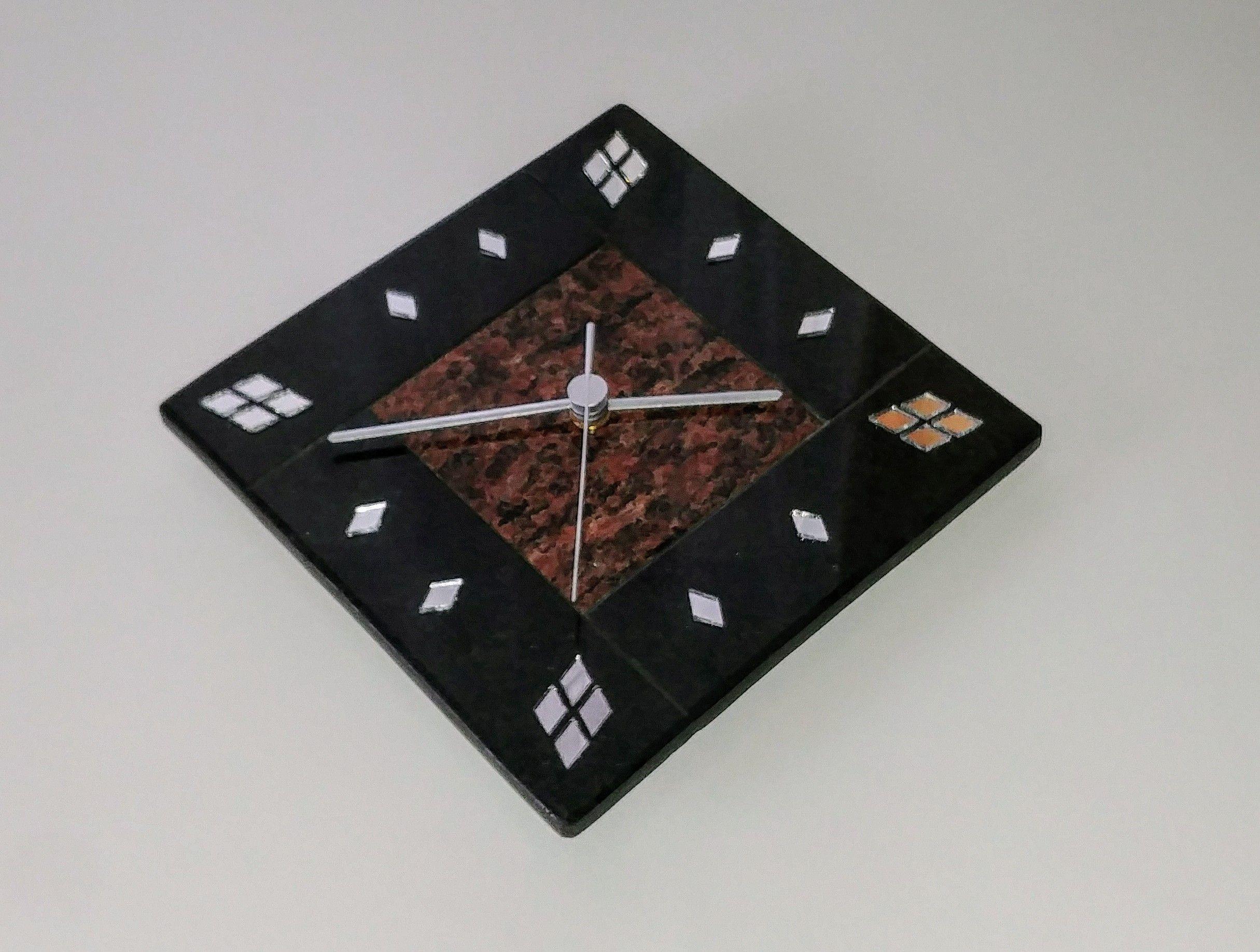 Handmade wall clock made of granite.
