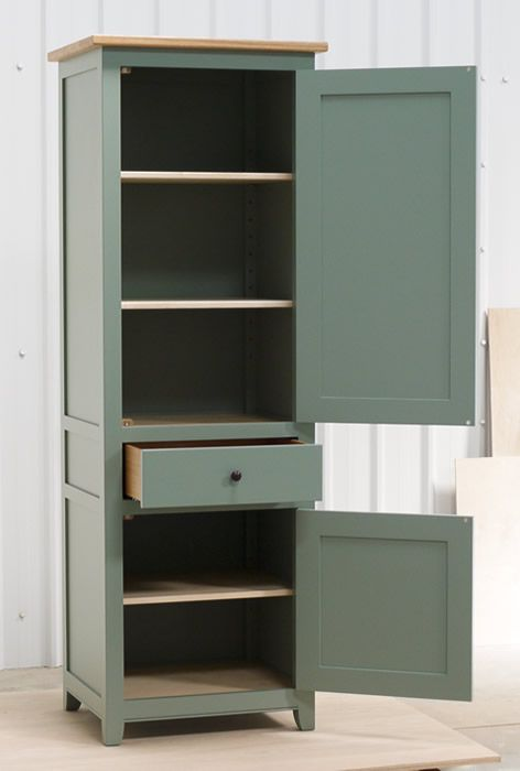 Small larder cupboard handpainted in Farrow and Ball Estate Eggshell - Castle Gray. Solid maple carcass construction with birch ply panels and shelves. Oak dovetailed drawers and oak cornice.
