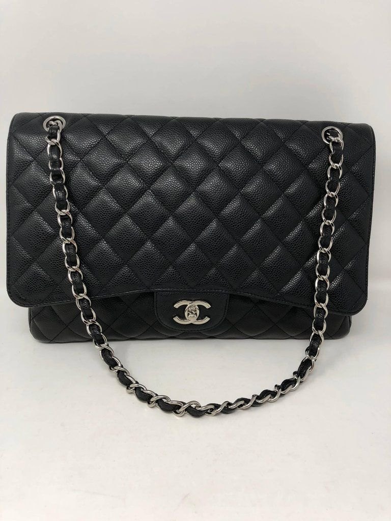 dc76b09631ff Black Caviar Chanel Maxi Single Flap bag with silver hardware. Durable Caviar  leather is great for every day usage. Can be worn doubled or as a crossbody.