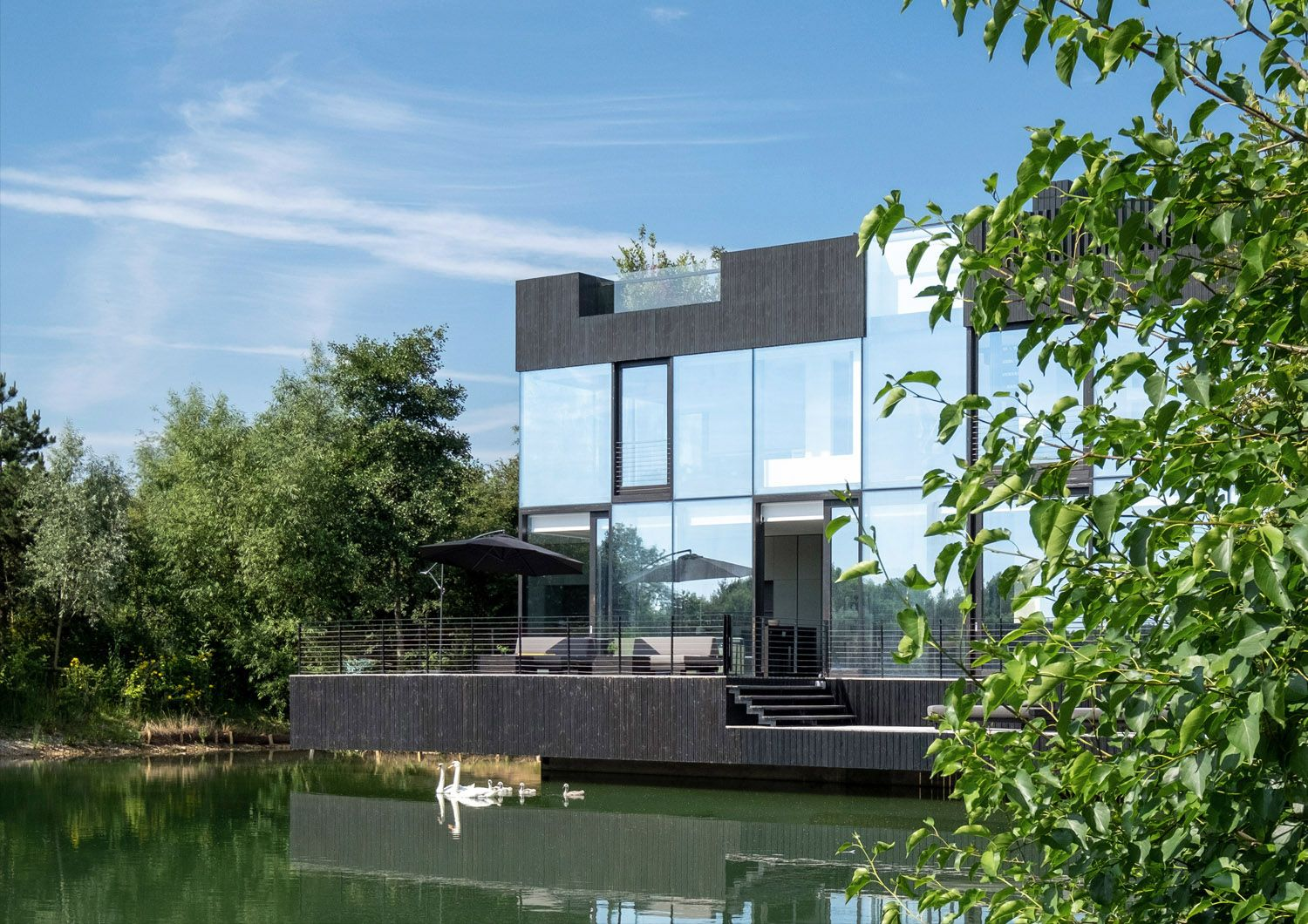 Glass Villa on the lake Lechlade, United Kingdom | Blue sky ...