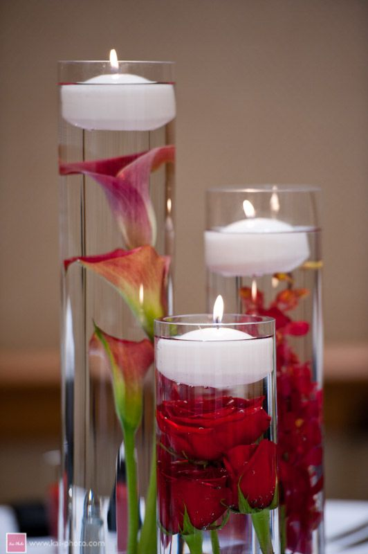 Red calla lilies roses and mokara orchids submerged in