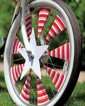 Fourth of July bike decorations: spoke covers. You don't see kids do this very often anymore. Let's get it going again! It's so fun.    #play #kids #decorations #fourthofjuly