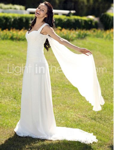I like the train coming off the top of the dress (but I would prefer one, not two)