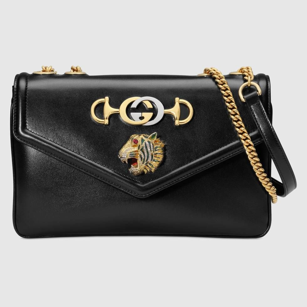 82c084972a8e Shop the Medium shoulder bag with tiger head by Gucci. The Fall Winter 2018  fashion show set the stage for the introduction of new elements