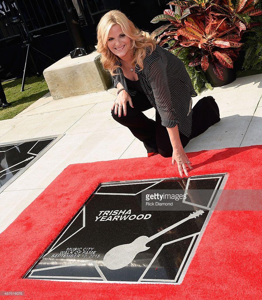 Garth Brooks and Trisha Yearwood are Inducted Into The Nashville Walk Of Fame. (pictured) Trisha Yearwood on her Star at the Nashville Music City Walk of Fame on September 10, 2015 in Nashville, Tennessee.