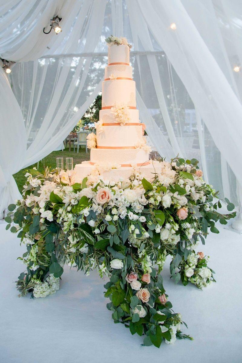 Tall White Wedding Cake With Rose Gold Ribbon Fresh Flowers Flower