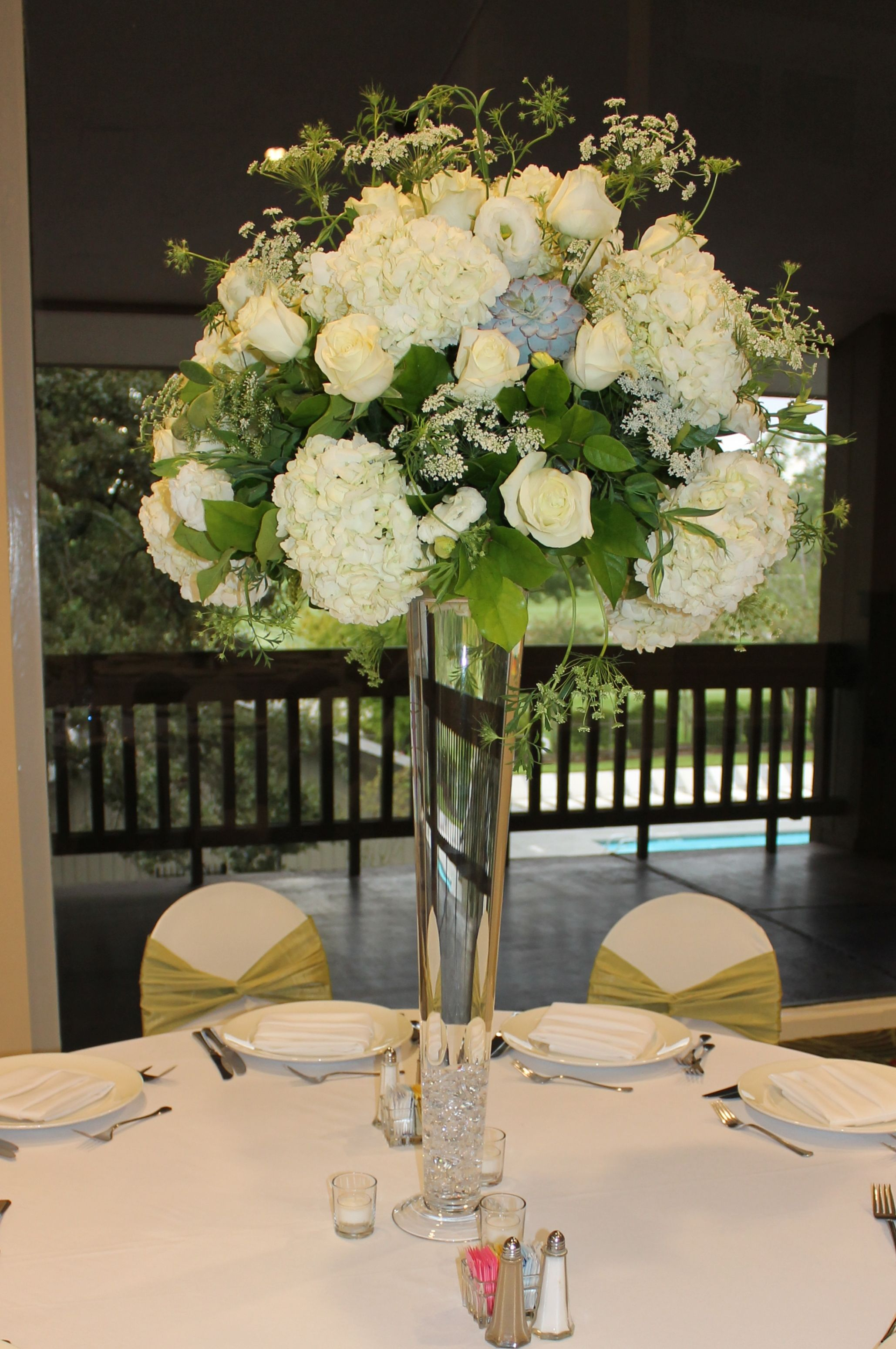 Tall centerpiece with white hydrangea roses queen anne s
