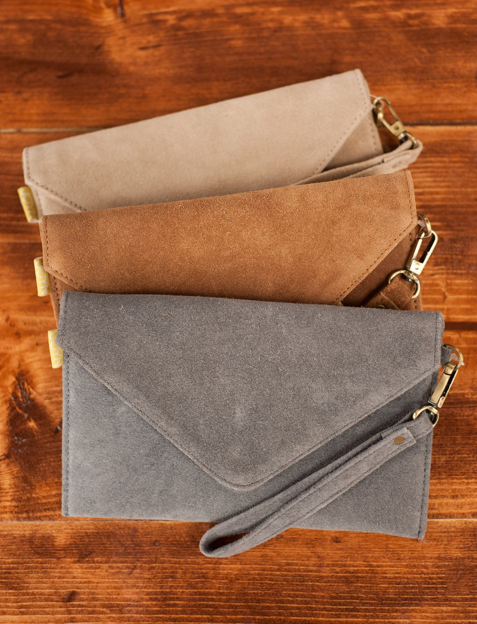 """We predict you will keep this forever. Here's why: 1. It's beautiful suede 2. It's easy to carry and your phone perfectly fits 3. It simply """"goes"""" everywhere and with everything 4. Did we mention it's"""