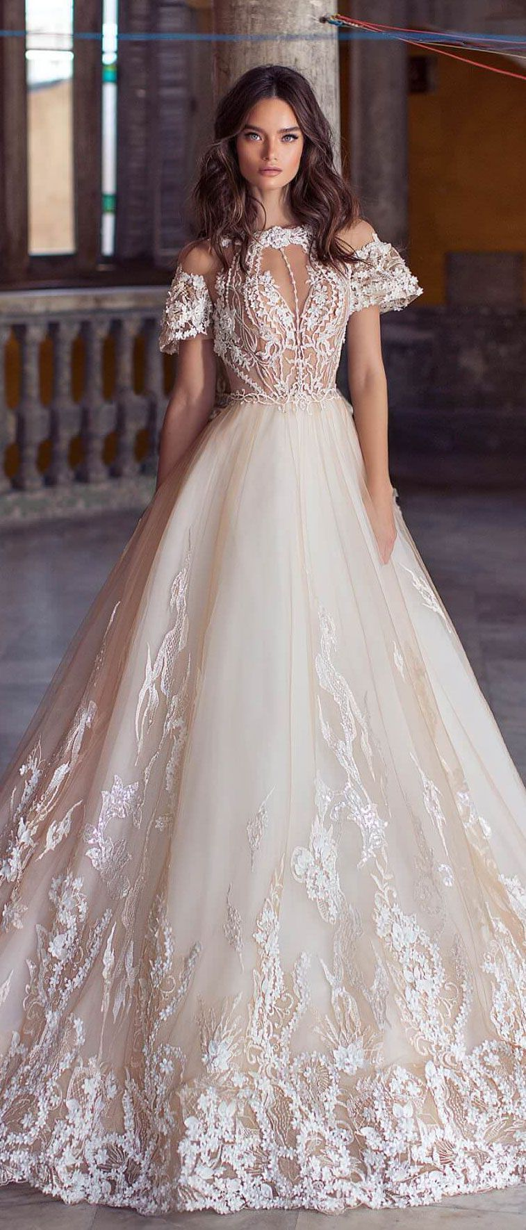 Tulle skirt wedding dress  Tulle skirt adorned with threedimensional floral appliqués and
