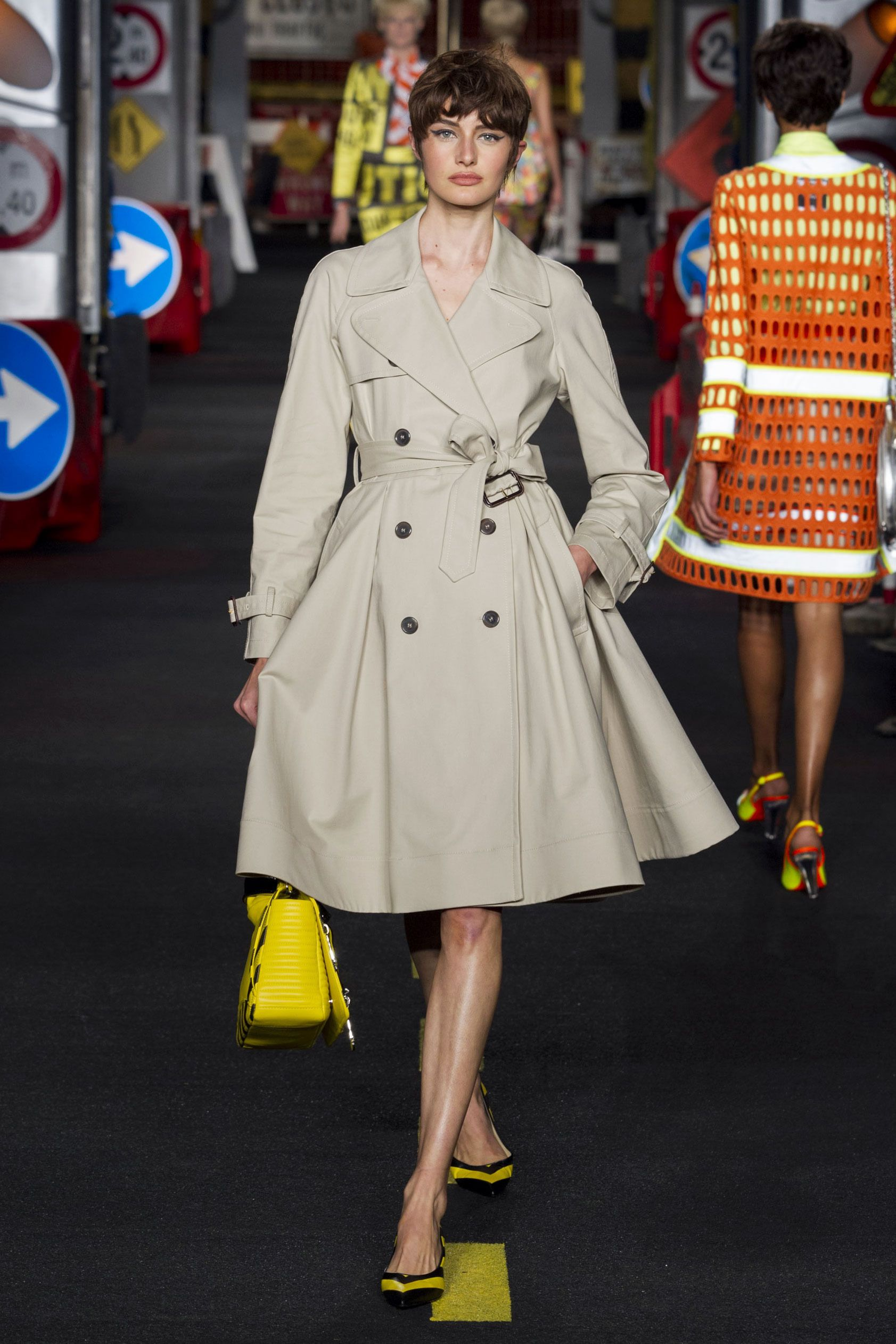 """Moschino Milan: back has a yellow center that says 'Caution Open Trench""""  lol"""