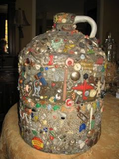 Vintage Memory Jug. They were made by placing everyday items such as tokens, bits of jewelry, shards of pottery, etc., into a clay that covered a jar, bottle or crock.