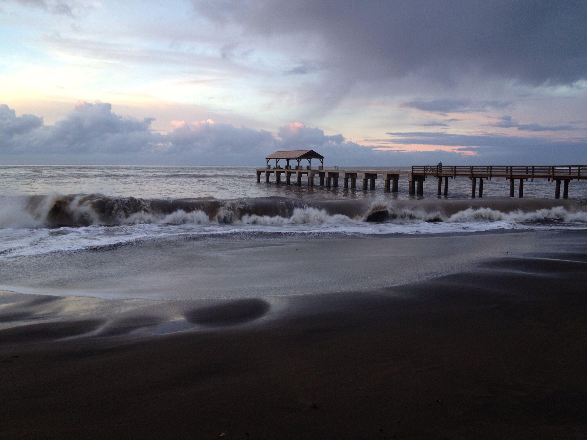 Black Sand Beach In Waimea Kauai With Pier Background