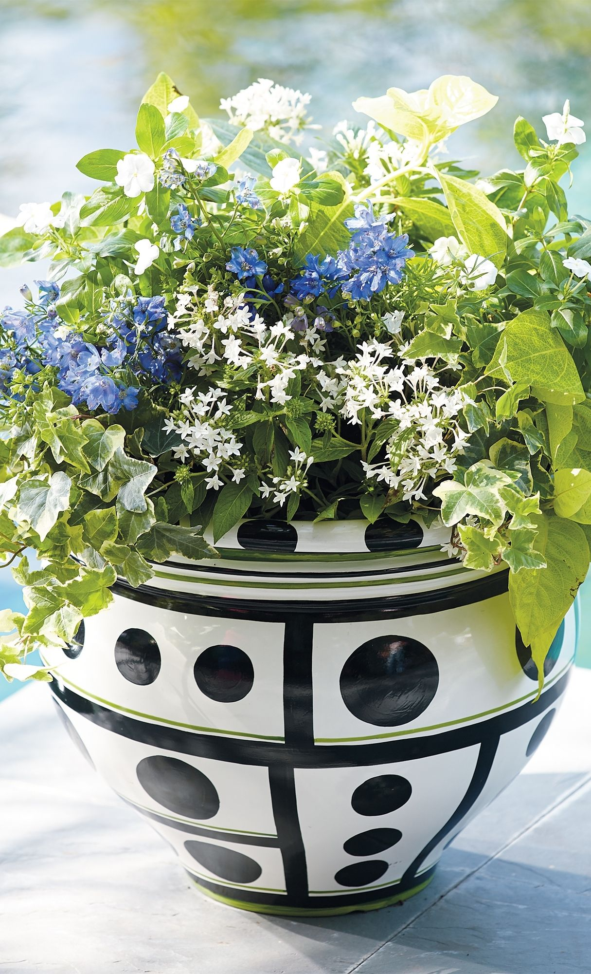 """Be charmed, be surprised, be happy! A modern design and lustrous finish make it impossible not to smile at our """"Be Happy"""" Planter."""