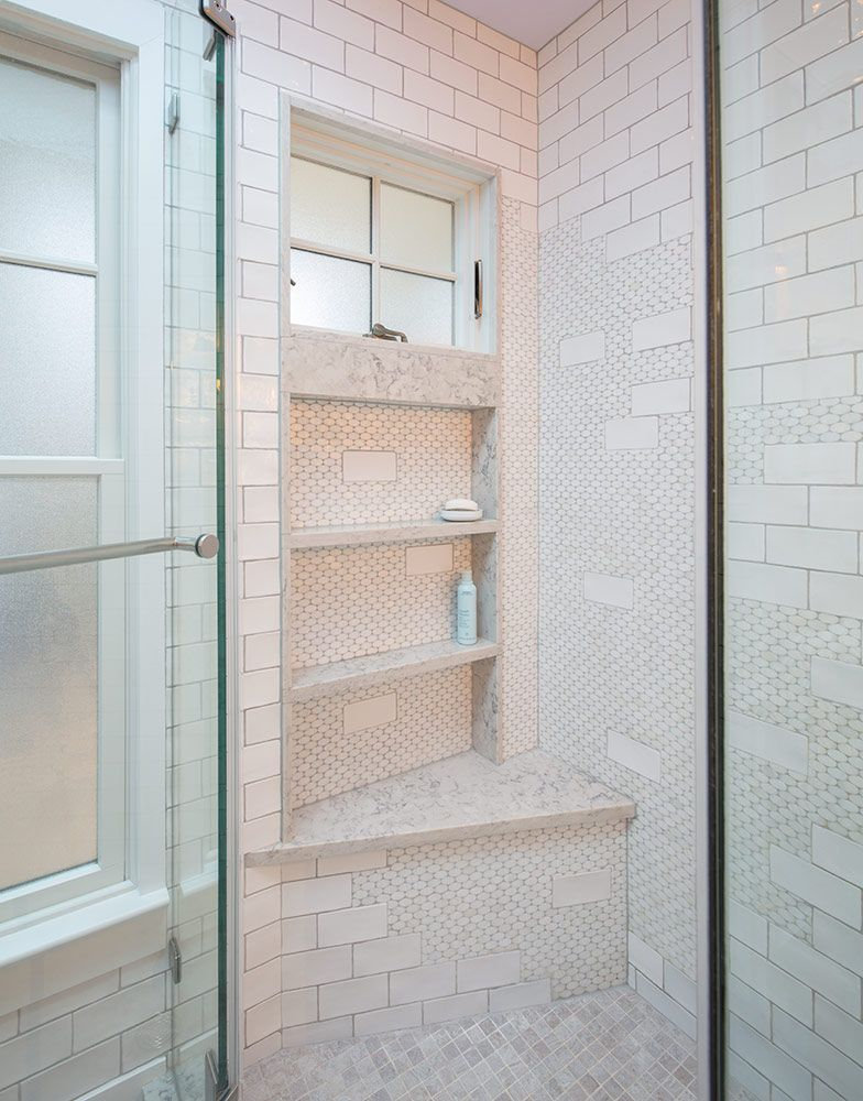A custom shower with bench and storage niches was enhanced by adding ...